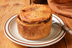 Gourmet steak pot pie. A gourmet pot pie with steak, ale, vegetables and mushrooms royalty free stock photos