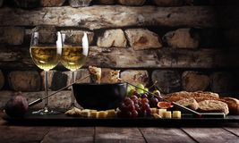 Gourmet Swiss fondue dinner on a winter evening with assorted ch royalty free stock photography