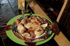 Gourmet Swordfish and grilled vegies. Delightful succulent grilled swordfish with a tangy tomato orange salsa with a medley of grilled vegies in a tangy lemon Stock Image