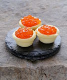 Gourmet tartlets with red caviar Stock Photos