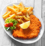 Gourmet Tasty Crumbled Schnitzel and Crispy Fries Stock Photo