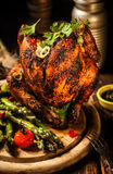 Gourmet Tasty Grilled Beer Can Chicken Meat on Wooden Board Stock Photography