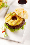 Gourmet Tasty Hawaiian Burger on a White Plate Stock Image