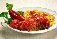 Gourmet Tasty Lobster with Linguine Pasta on Plate Royalty Free Stock Images