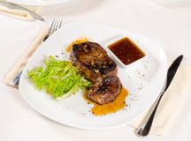 Gourmet Tender Juicy Grilled Meat on White Plate Stock Images