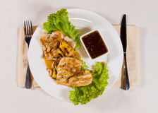 Gourmet Tender Juicy Meat Dish with Hot Sauce Royalty Free Stock Photography