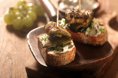 Gourmet Toasted Bread with Roasted Rolled Fish Royalty Free Stock Images