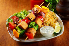 Gourmet Tofu Skewers on Java Rice with Mustard Sauce Royalty Free Stock Photos