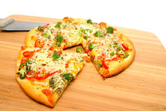Gourmet Veggie Pizza. A slice of gourmet veggie pizza topped with sharp cheddar and asiago cheese, fresh tomatoes, red bell pepper, mild jalapeno chili, broccoli Stock Photos