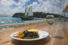 A gourmet West Indian meal prepared onboard a traditional schooner Royalty Free Stock Images