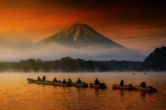 Sailing boats at Lake Shoji with Fujisan. Gourp of sailing boats at Lake Shoji in morning at sunrise with dense mist in Yamanashi Prefecture, Japan. Silhouette stock photography