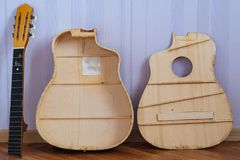 Guitar parts. Grand Auditorium guitar parts for restoration: opened body, back of a deck and a neck stock photography