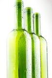 Gouttelettes d'eau sur les bouteilles de vin effrayantes Photographie stock libre de droits