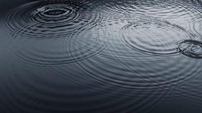 Gouttelettes de pluie sur la surface de l'eau Images libres de droits