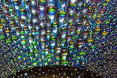 Gouttelettes sur le CD Image stock