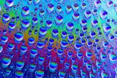 Gouttes de l'eau multicolores Photo libre de droits