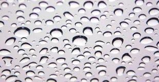 Gouttes de l'eau sur la glace photographie stock