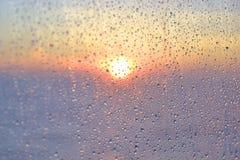 Gouttes de l'eau sur la glace Photo libre de droits