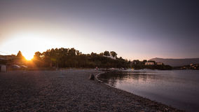 Gouvia för Korfu ösolnedgång strand, Grekland Fotografering för Bildbyråer