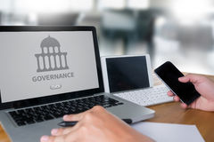GOVERNANCE and  building, Authority   Computing Computer  Laptop. With screen on table Silhouette and filter sun Royalty Free Stock Images