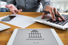 GOVERNANCE and  building, Authority   Computing Computer  Laptop. With screen on table Silhouette and filter sun Royalty Free Stock Photography