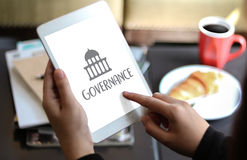 GOVERNANCE and building, Authority Computing Computer Laptop wit. H screen on table Silhouette and filter sun Stock Photo