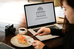 GOVERNANCE and building, Authority Computing Computer Laptop wit. H screen on table Silhouette and filter sun Stock Image