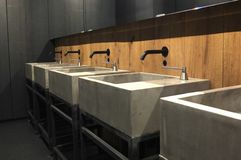 Industrially decorated washroom. Government basins industrial-style metal basics stock photos