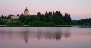 Government Building Capital Lake Olympia Washington Sunset Dusk. The state capital reflects in the lake of the same name at dusk in Olympia, Wa Royalty Free Stock Photos