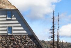 Section of Timberline Lodge and two snags Stock Photos
