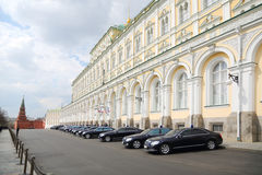 Government cars are near Grand Kremlin Palace Stock Image