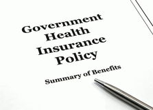 Government Health Insurance Policy and Pen Royalty Free Stock Images