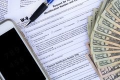 Government income tax forms and money Stock Photo