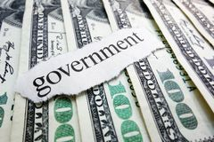 Government money. Government newspaper scrap on assorted money stock image