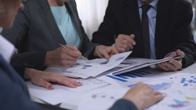 Government officials discussing import and export report diagrams, research. Stock footage stock video footage