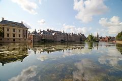 The government and Parliament buildings in The Hague reflection on the water of pool Hofvijver in the Netherlands. The government and Parliament buildings in stock photos