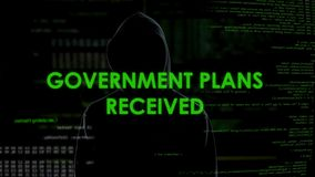 Government plans received, scary shadow hacker planning country defense attack. Stock footage stock video