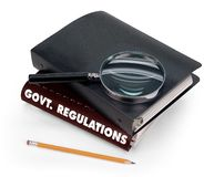 Government regulations. Magnifier, pencil on white Royalty Free Stock Photography