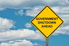 Government Shutdown Warning Sign. Government Shutdown Ahead Caution Sign Blue Sky Background stock image