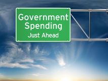 Government spending just ahead . Street exit sign showing the increase of government spending in the future. Stock Image