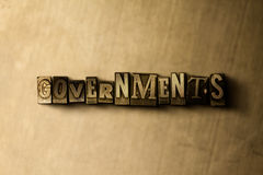 GOVERNMENTS - close-up of grungy vintage typeset word on metal backdrop Stock Photography