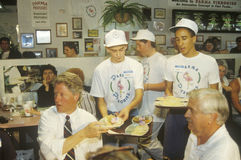 Governor Bill Clinton dines with the owner of Parma Peiroges Restaurant during the Clinton/Gore 1992 Buscapade campaign tour in Pa. Rma, Ohio Royalty Free Stock Photo
