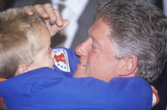 Governor Bill Clinton embraces a child at a Denver campaign rally in 1992 on his final day of campaigning in Denver, Colorado Royalty Free Stock Photography