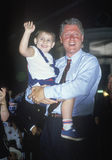 Governor Bill Clinton holds a child Royalty Free Stock Photo