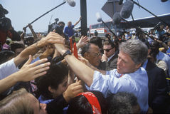 Governor Bill Clinton shakes hands at an unscheduled bus stop on the Clinton/Gore 1992 Buscapade campaign tour in Texas Royalty Free Stock Image