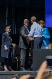Governor Jerrry Brown speaking with President Obama on stage Lake Tahoe Summit. Governor Brown on stage with President Obama, and Senators Feinstein & Boxer at Royalty Free Stock Photos