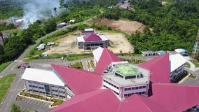 Roof with heliport. Governor´s office with heliport on top of the roof - building in shape of star in Manokwari, Papua Barat, Indonesia stock footage