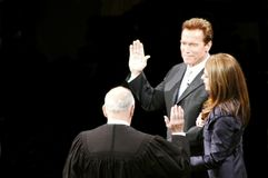 Governor Schwarzenegger. California Governor Arnold Schwarzenegger taking oath of office with California Chief Justice Ronald M. George at his inauguration Stock Photo