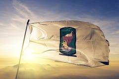 Governorate de Sohag da tela de pano de matéria têxtil da bandeira de Egito que acena na névoa superior da névoa do nascer do sol fotografia de stock royalty free