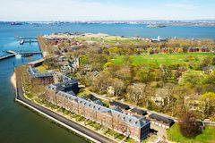 Governors Island in Upper New York Bay NYC. Aerial view from helicopter on Governors Island in Upper New York Bay. New York City, NYC, USA. Liberty Island is on royalty free stock photo